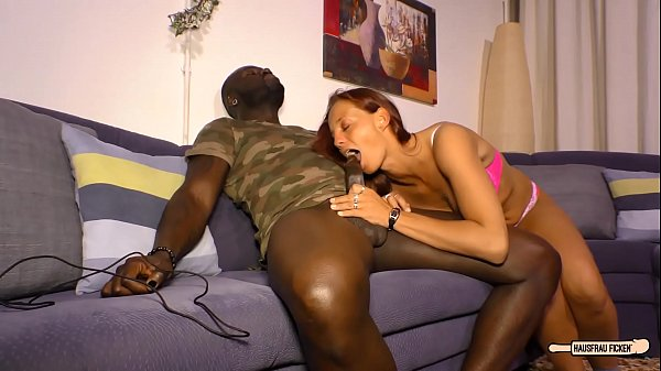 HAUSFRAU FICKEN - Black on white sex and cum on tits with mature German redhead Thumb