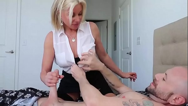 Milf Babe Knows Her Mans Up For A Handjob