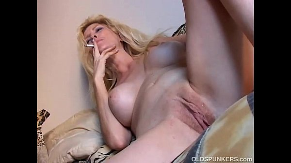 Beautiful blonde MILF enjoys a smoke break Thumb
