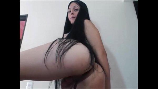 Brunette tranny jerks off to orgasm