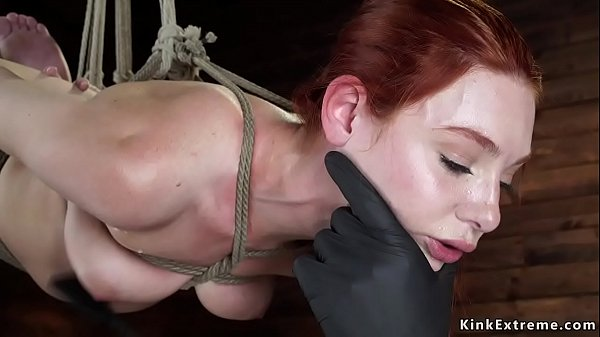 Hogtied redhead suffers suspension