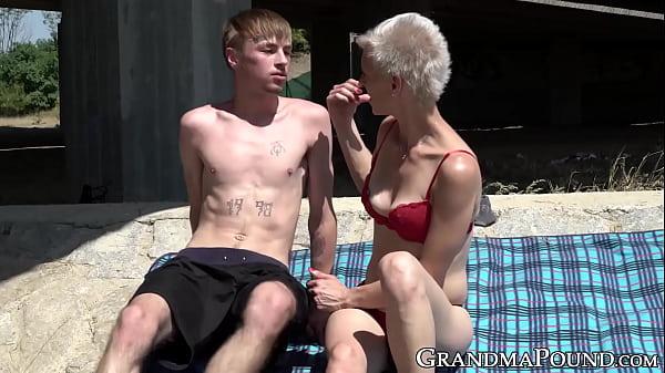 Pixie grandma swallows young cock beneath bridge Thumb