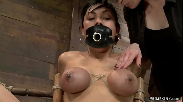 Hogtied gagged brunette is whipped Thumb