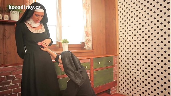 Two sexy catholic nuns praying togather in the lesbian touch
