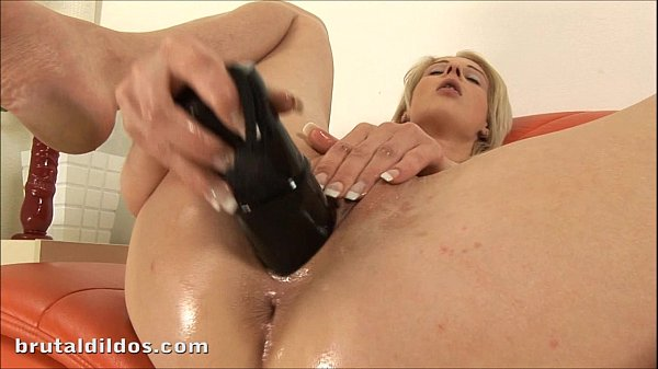 Blonde amateur punishes her pussy with a huge black dildo