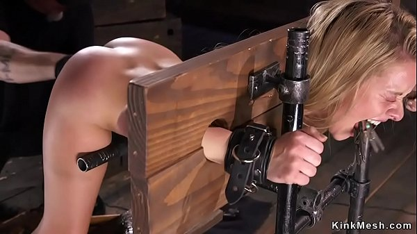 Bent over blonde in stock gets fisted Thumb