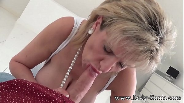 British Lady Sonia finds friends son on her bed, and sucks his cock