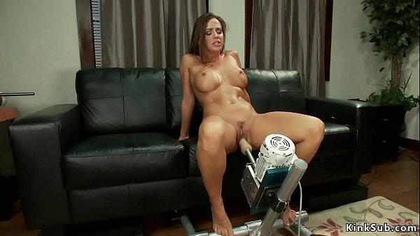 Busty babe has intense orgasm on machine Thumb