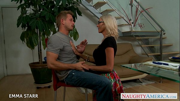 Blonde babe in glasses Emma Starr gives titjob Thumb