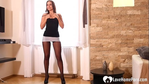 Gorgeous stepmom teases in some black pantyhose