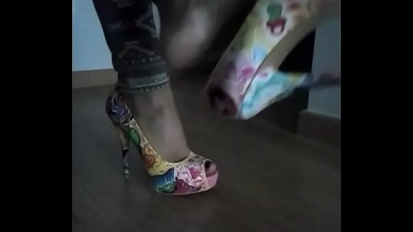 Domina playing with shoes