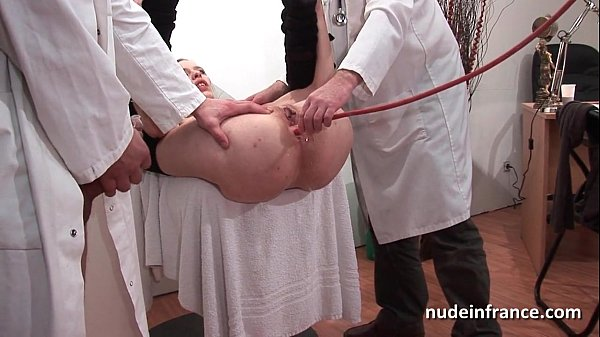 Naughty blonde ass plugged in threesome at the gyneco Thumb