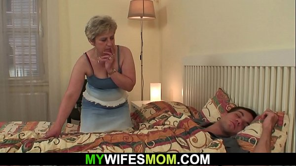 Horny old m. awakes him to ride his cock