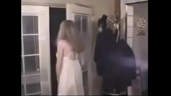 Mature woman gives a teen boy a hand Job