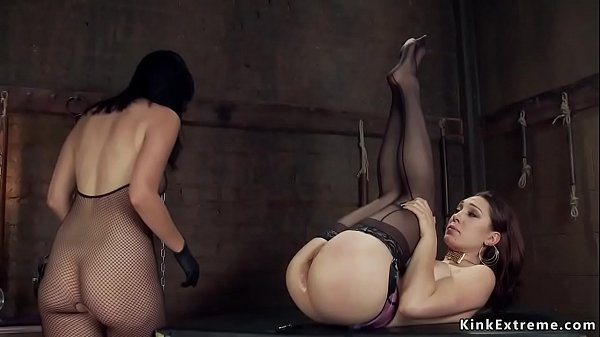 Lesbian dom in fishnets anal fists babe