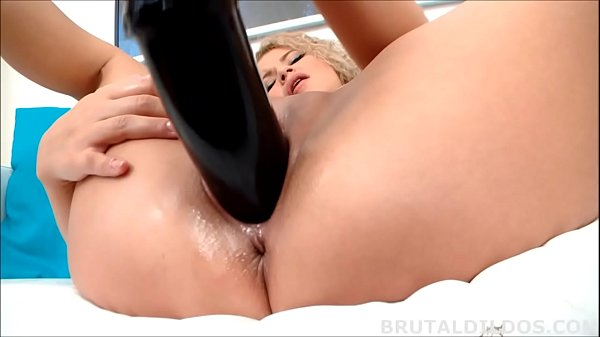 Petite blonde filling her shaved pussy with thick dildo Thumb