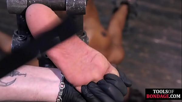 Black BDSM slave bound for foot domination