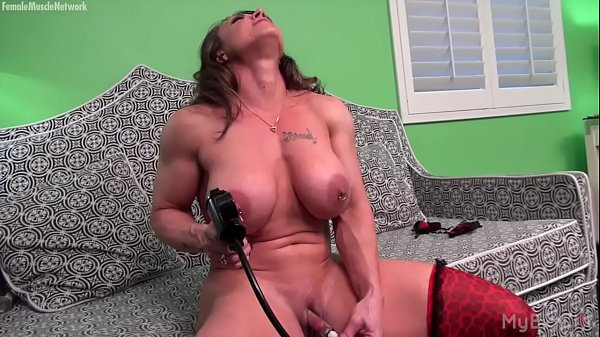 Naked Female Bodybuilder Pumps Her Big Clit