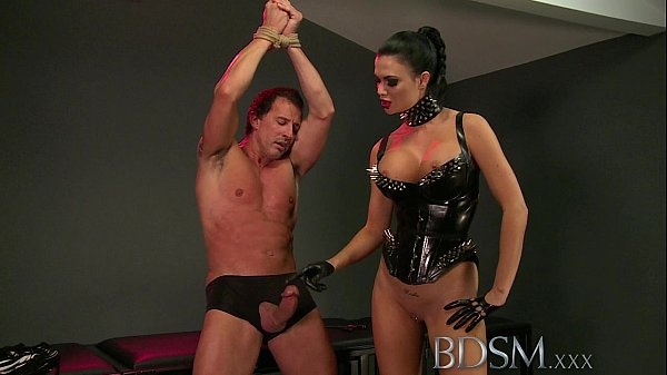 BDSM XXX Slave boy in metal stocks as he receives anal attention Thumb