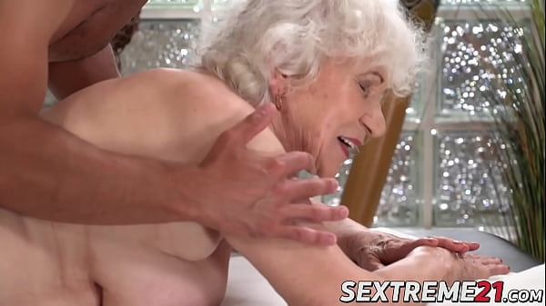 Horny granny Norma needs young hard cock on a massage table Thumb