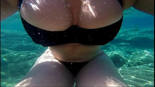 Milf in black bikini underwater