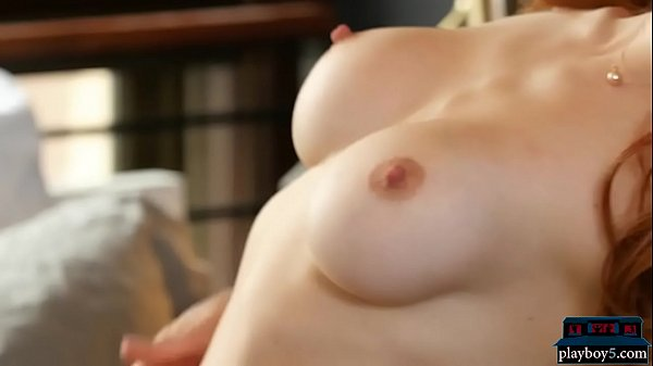 American redhead MILF with juicy boobs strips naked Thumb