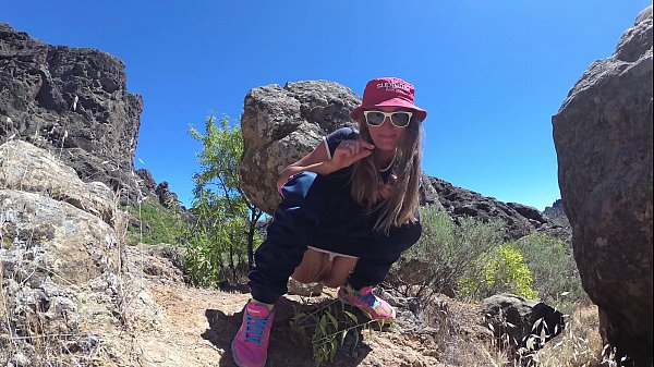 PISS PISS TRAVEL - Young girl tourist peeing in the mountains Gran Canaria. Public Canarias Thumb