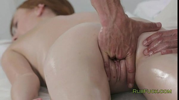 Pale redhead pussy fingered by masseur