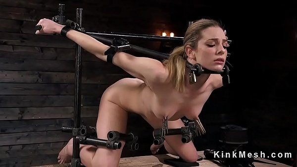 Slave in device bondage with exposed ass