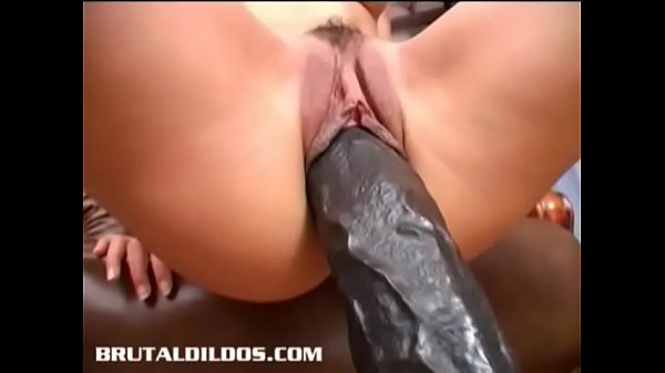 Slim brunette Demia gapes her pussy with a b. dildo