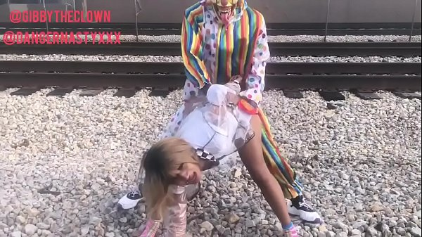 Clown fucks girl on train tracks Thumb