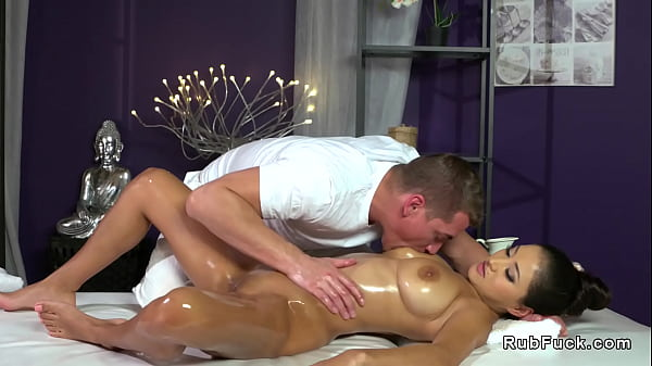 Brunette with big natural tits gets massage