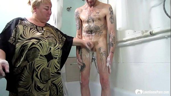 Blonde stepmom jerks and sucks off her stepson