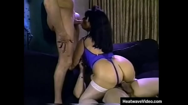 There is a somewhat slutty smile on the face of voluptuous MILF as she gets surrounded by many fuckers