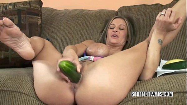 Busty cougar Leeanna Heart masturbates with a cucumber Thumb