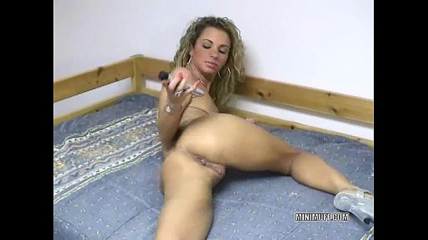 Petite Holly fucks her ass with a toy