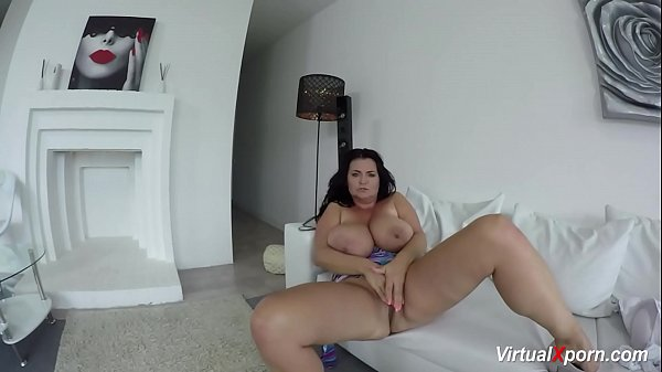 Busty Reny shows her gigantic boobs at the camera Thumb