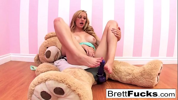 Busty Brett Rossi plays with a stuffed bear's strap-on dildo