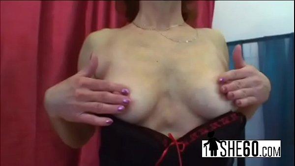 Horny elderly woman pleasing her slit