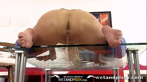 Sexy blonde Carla enjoys wet and messy foot play