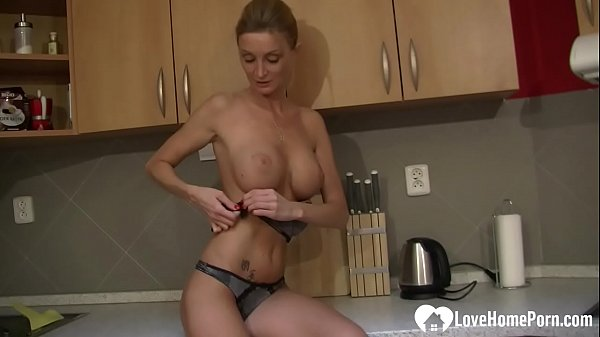 Blonde MILF strips and pleasures herself passionately