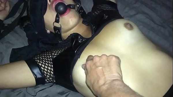 Submissive Slave with GagBall Thumb