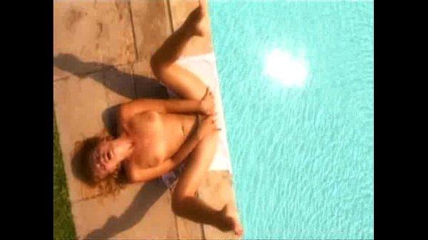 Sexy girl masturbates by the pool