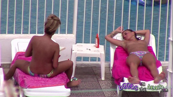 Topless sisters tanned and oiled up with pierced nipple & tattoos 3of3