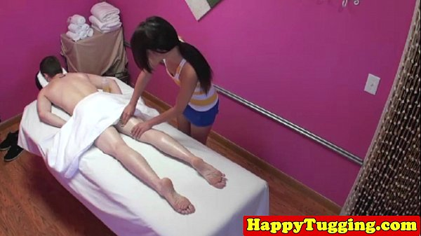 Asian masseuse tugging client