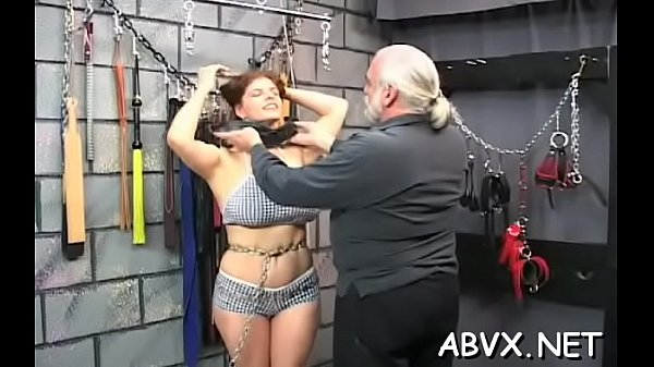 Astonishing maiden is playing with her massive tits her