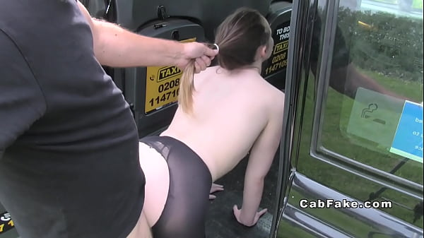 Brunette in tights bangs in fake taxi