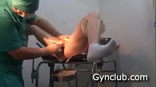 Examination on the gynecological chair of a dildo and a vibrator (04)
