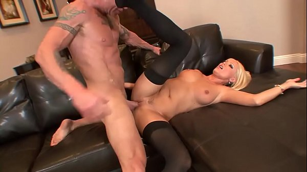 Blonde in stockings gets hard fuck on the sofa