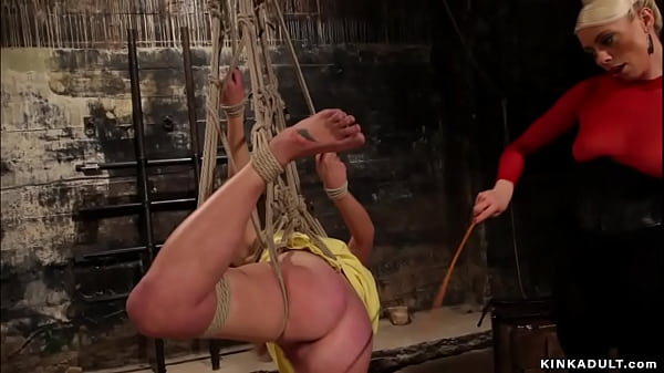 Bound lesbian ass caned and fucked